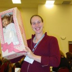 Soroptimist member Brooke playing Vana with a collectors doll