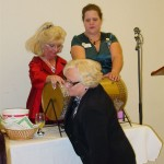Drawing the winning wine ticket is Soroptimist member Margaret MacRae along side Kerry Jarvi and Shirley McCoy