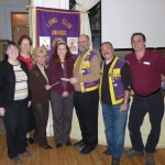 Soroptimist and the Ancaster Lions present a cheque to McMaster