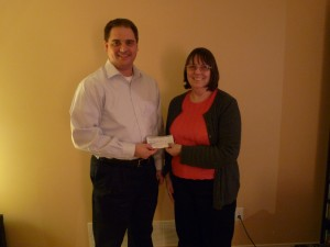 Pauline Hardcastle presents a cheque to Paul Johnson, Director of the Welsley Urban Ministries