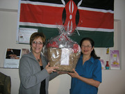 Registered Nurse Gail Wolters (left) and Blanca Pena show off the gift basket that donors to Nurses For Africa have a chance to win. Photo by Dianne Cornish, Review